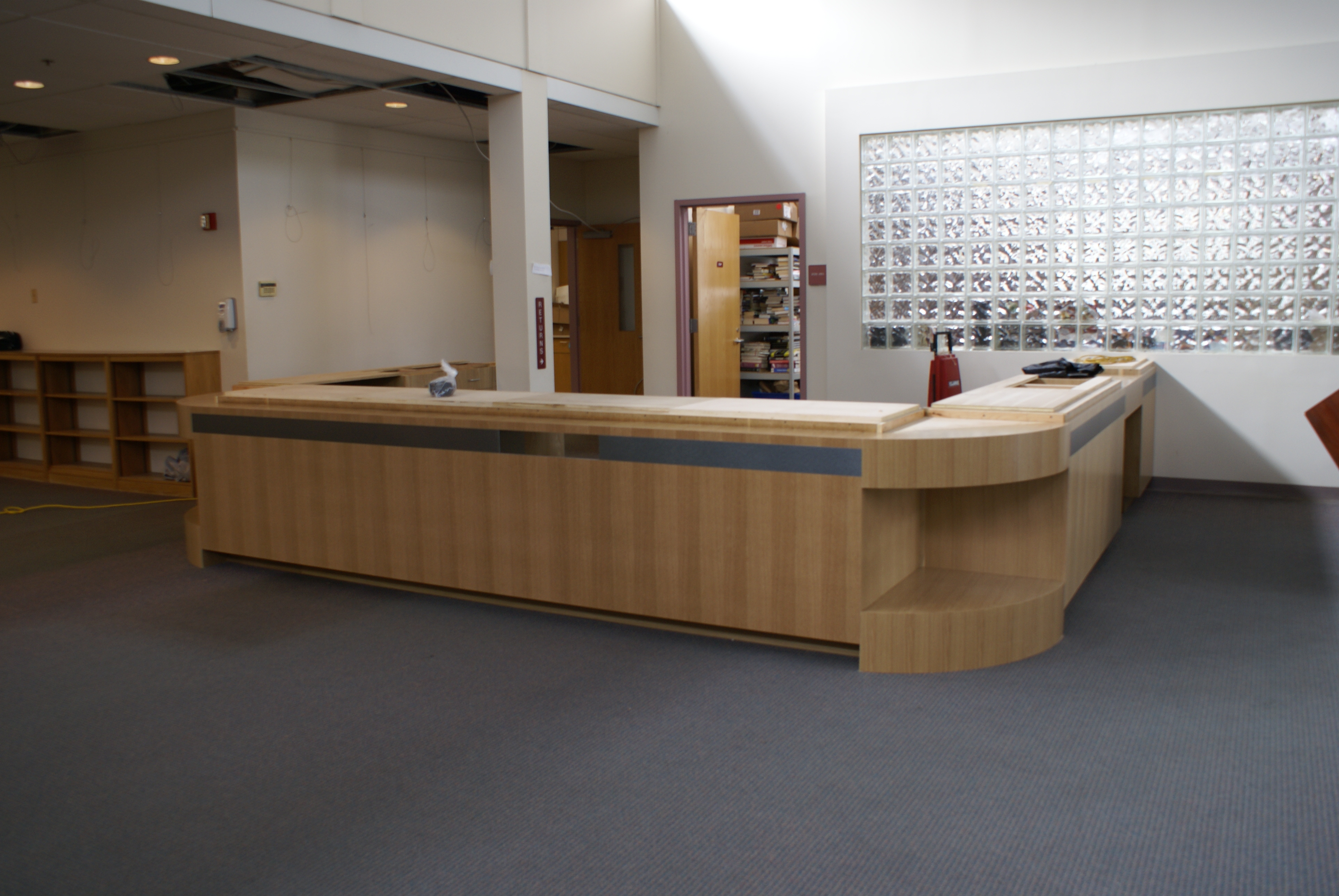 the desk is in place at the library awaiting delivery of the solid surface counter photo suzan globus - Library Circulation Desk Design